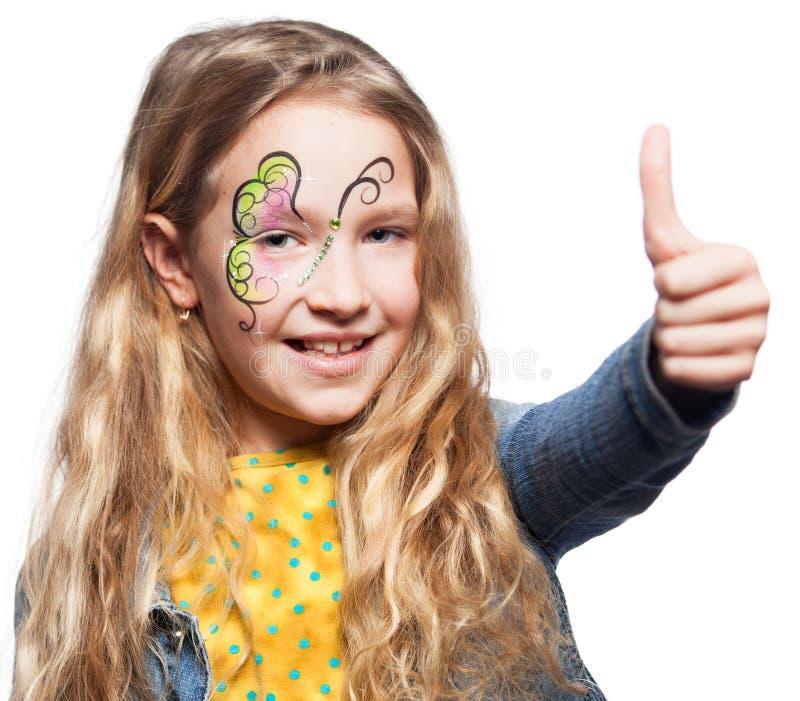 το πρόσωπο παιδιών κάνει να χρωματίσει επάνω στοκ φωτογραφίες