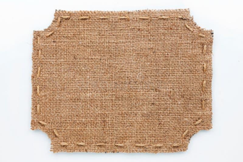 Το πλαίσιο burlap, βρίσκεται σε ένα άσπρο υπόβαθρο στοκ εικόνα