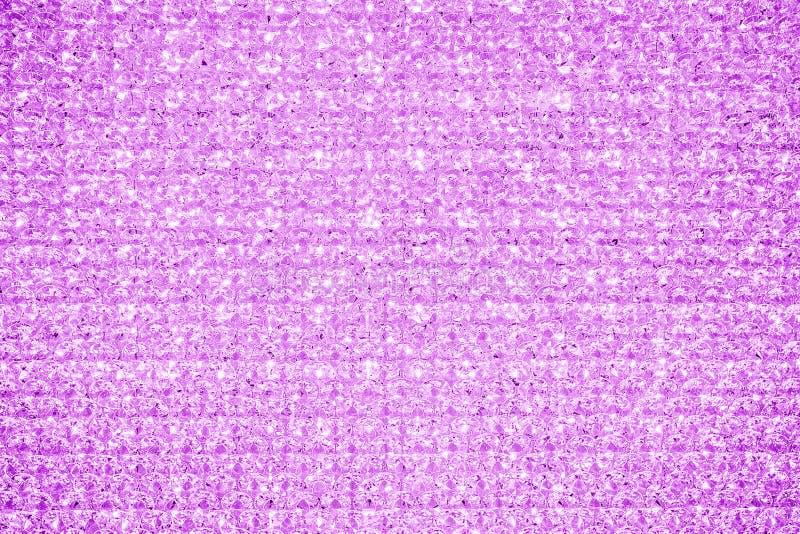 Το ρόδινο φούξια κρύσταλλο ακτινοβολεί υπόβαθρο σύστασης Λαμπρά φω'τα Glittery στοκ εικόνες