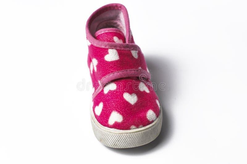 Το ρόδινο children' πάνινα παπούτσια του s που απομονώνονται σε ένα άσπρο υπόβαθρο Children' παπούτσια του s Παπούτσια γι στοκ εικόνες με δικαίωμα ελεύθερης χρήσης