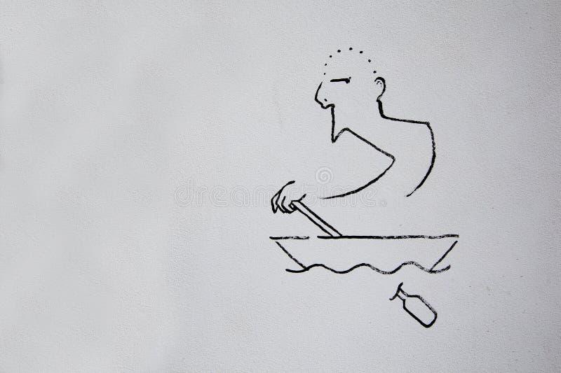 Το στρέθιμο της προσοχής στον άσπρο τοίχο στο μαύρο χρώμα, απεικονίζει ένα άτομο σε μια βάρκα που επιπλέει στα κύματα στοκ φωτογραφίες