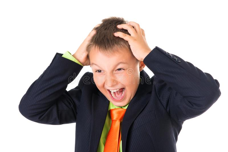 Το συναισθηματικό πορτρέτο του πανικού συνέχυσε το ευφυές σχολικό αγόρι με τα χέρια στο επικεφαλής, άσπρο υπόβαθρο στοκ εικόνες με δικαίωμα ελεύθερης χρήσης