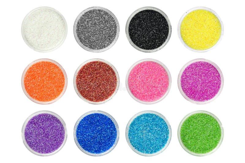 Το σύνολο δώδεκα διαφορετικών χρωμάτων ακτινοβολεί μόρια στα ανοικτά εμπορευματοκιβώτια, άποψη άνωθεν Μπορέστε να χρησιμοποιηθείτ στοκ φωτογραφίες