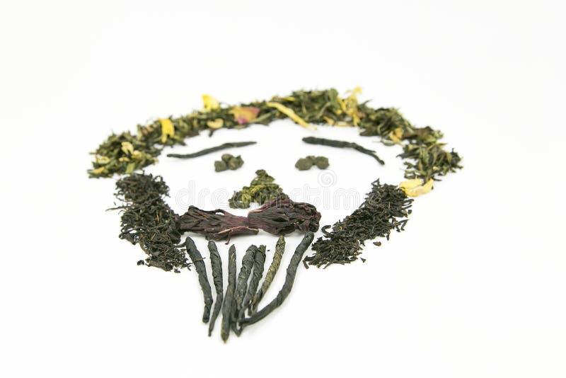 Το τσάι των διαφορετικών ποικιλιών σχεδιάζεται σε ένα άσπρο υπόβαθρο υπό μορφή εικόνας - ένα πρόσωπο προσώπων ` s! Η εικόνα χρησι στοκ εικόνες