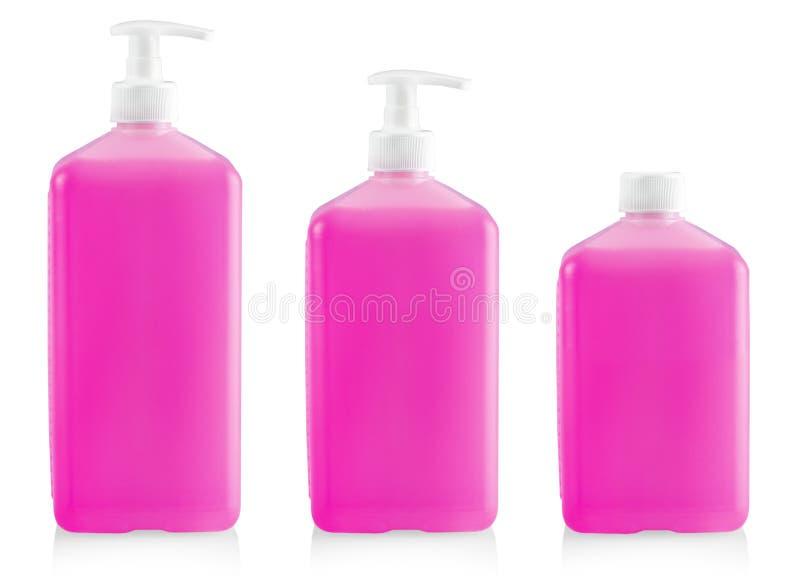 Το υγρό εμπορευματοκιβώτιο για το πήκτωμα, λοσιόν, κρέμα, σαμπουάν, λουτρό από το ρόδινο καλλυντικό πλαστικό μπουκάλι με την άσπρ στοκ εικόνα