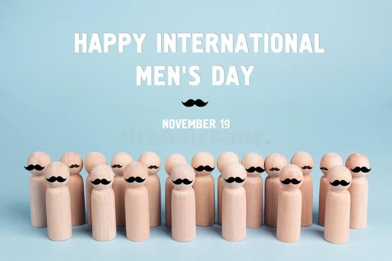 Το υπόβαθρο ημέρας των διεθνών ατόμων με τις ξύλινες κούκλες με το α πρέπει στοκ φωτογραφία με δικαίωμα ελεύθερης χρήσης