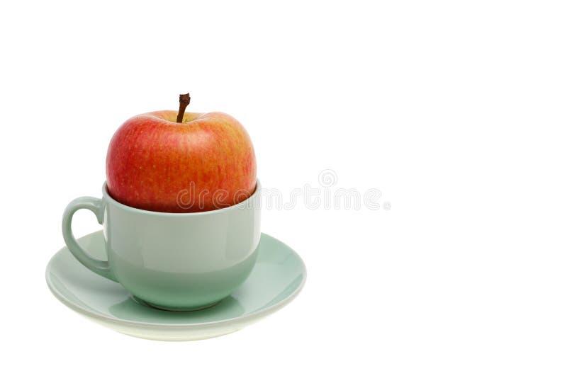 Το φλυτζάνι της Νίκαιας του αχνιστού τσαγιού μήλων κοιλαίνει έναν υγιή καλό τρόπο προγευμάτων στοκ εικόνες