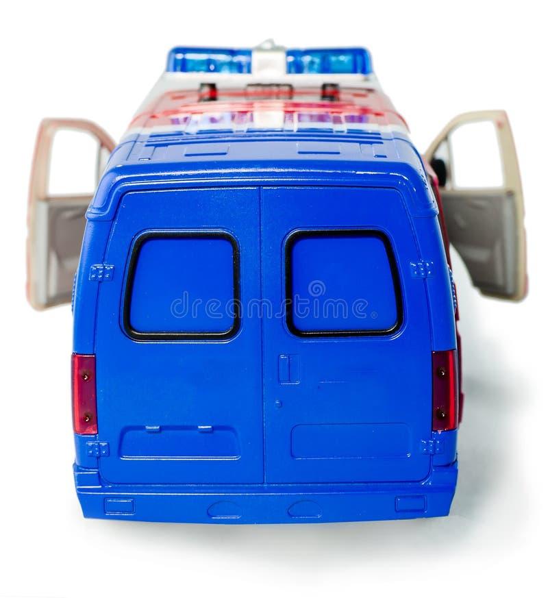 Το φορτηγό αστυνομίας παιχνιδιών με τις ανοιγμένες πόρτες βλέπει πίσω Πλαστικό περιπολικό της Αστυνομίας παιχνιδιών παιδιών με απ στοκ εικόνα με δικαίωμα ελεύθερης χρήσης