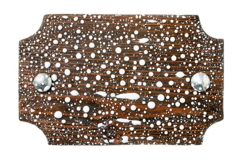 Το φυσικό πλαίσιο έκανε από τη σανίδα με τα μπουλόνια μετάλλων στις πτώσεις του άσπρου χρώματος απομονωμένος στοκ εικόνα με δικαίωμα ελεύθερης χρήσης