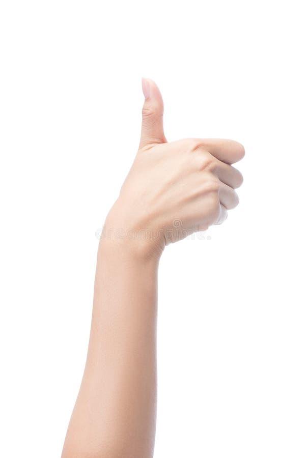 Το χέρι γυναικών που παρουσιάζει αντίχειρες υπογράφει επάνω στοκ εικόνες