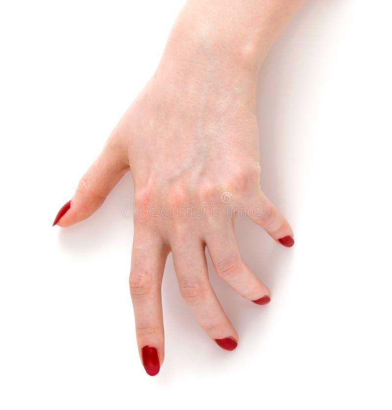 το χέρι καρφώνει την κόκκινη γυναίκα στοκ εικόνα