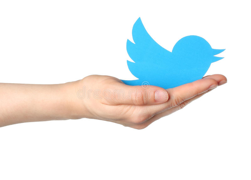 Το χέρι κρατά το πουλί πειραχτηριών logotype στοκ φωτογραφίες με δικαίωμα ελεύθερης χρήσης