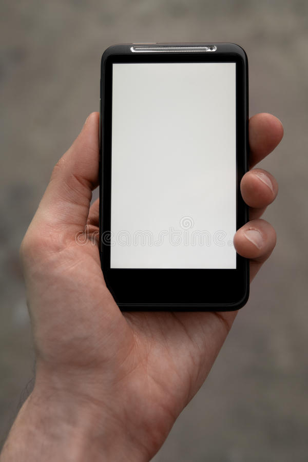 το χέρι κρατά το τηλέφωνο έξ&upsil στοκ φωτογραφία με δικαίωμα ελεύθερης χρήσης
