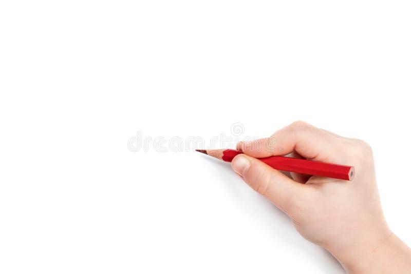 Το χέρι παιδιών κρατά ένα μολύβι στοκ εικόνα με δικαίωμα ελεύθερης χρήσης