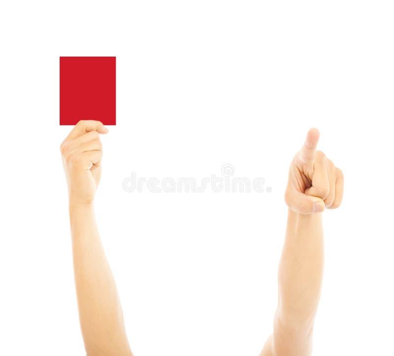 Το χέρι του διαιτητή με την κόκκινη κάρτα και δείχνει την κατεύθυνση στοκ φωτογραφίες με δικαίωμα ελεύθερης χρήσης