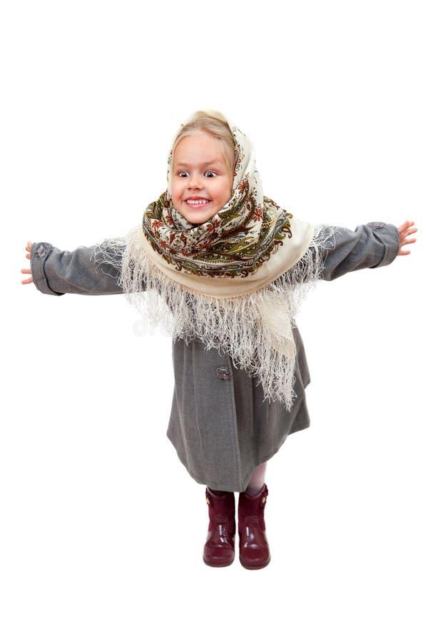 Το χαμογελώντας μικρό κορίτσι με την υποδοχή αγκαλιάζει στοκ φωτογραφία