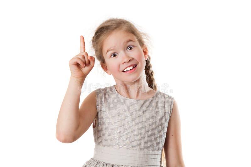 Το χαρούμενο κορίτσι παρουσιάζει ένα δάχτυλο στοκ φωτογραφίες