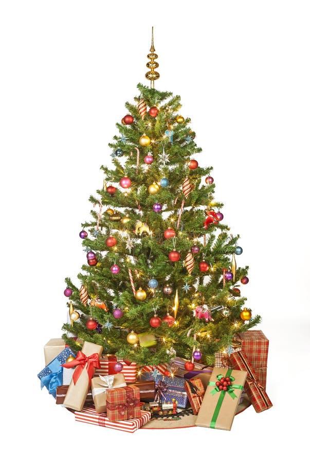 Το χριστουγεννιάτικο δέντρο με παρουσιάζει στοκ εικόνα