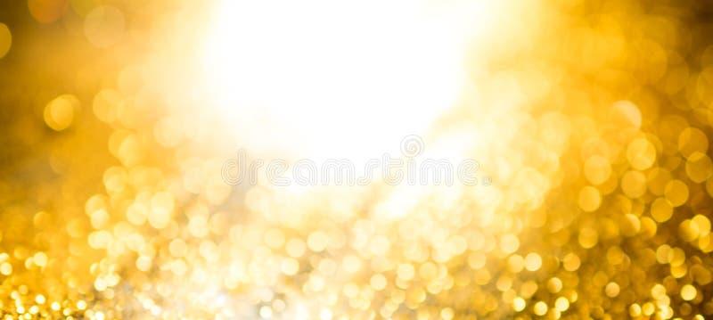 το χρυσό αφηρημένο υπόβαθρο bokeh η ευρεία σελίδα PA ανεμιστήρων φω'των στοκ φωτογραφίες