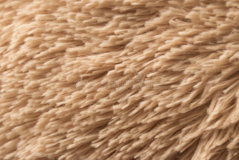 Το χρυσό ύφασμα Teddy τρίχας αντέχει τη σύσταση στοκ εικόνες