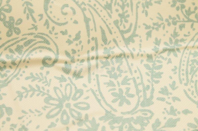 Το χλωμό Paisley ζάρωσε το κατασκευασμένο υπόβαθρο στοκ εικόνες