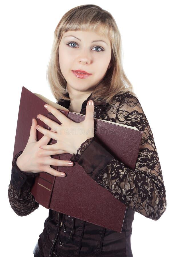 το όμορφο ξανθό βιβλίο κρα& στοκ εικόνες