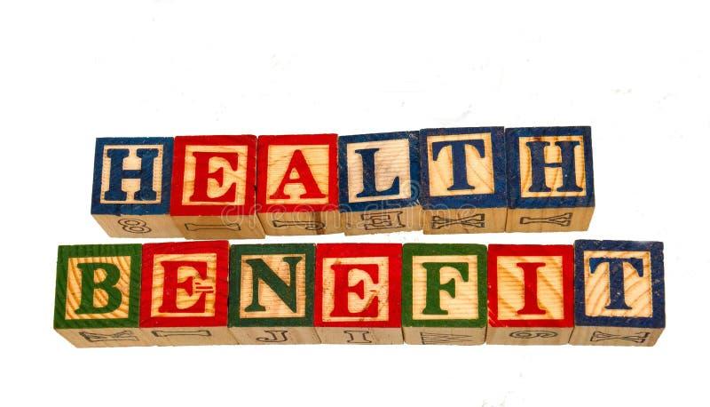 Το όφελος για την υγεία φράσης που επιδεικνύεται οπτικά σε ένα άσπρο υπόβαθρο στοκ φωτογραφία