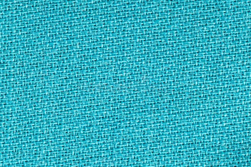 Το ύφασμα λινού στο τυρκουάζ χρώμα Σύσταση υποβάθρου υφάσματος Λεπτομέρεια της κινηματογράφησης σε πρώτο πλάνο υφαντικού υλικού στοκ φωτογραφία με δικαίωμα ελεύθερης χρήσης