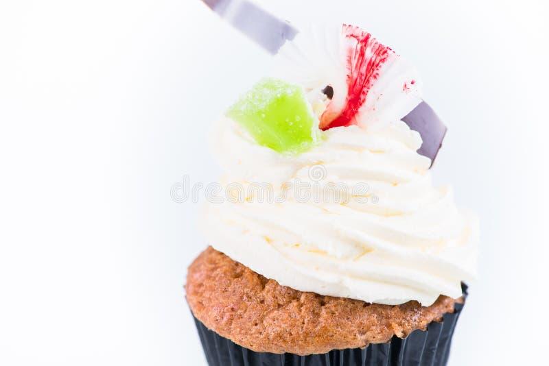 Το Cupcake που διακοσμείται με τη σοκολάτα διακοσμεί και πράσινη καραμέλα στοκ φωτογραφία με δικαίωμα ελεύθερης χρήσης