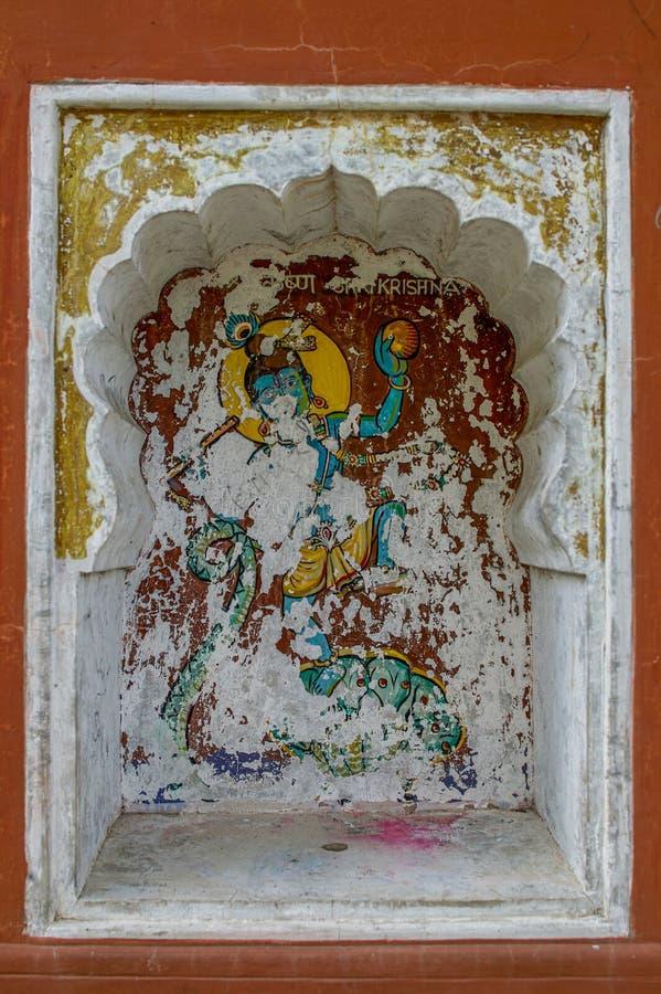 Το Krishnavtar ή η θεία όγδοη ενσάρκωση πολιτικών του Λόρδου Vishnu χρωμάτισε colourfully στον τοίχο του ναού Vishnu Narayan στην στοκ φωτογραφίες
