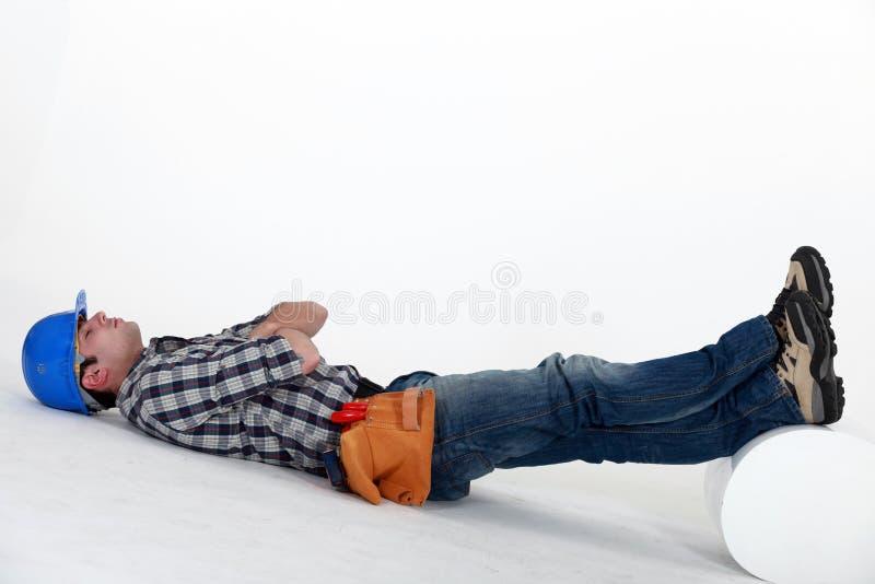 Το Laborer έβαλε στο πάτωμα στοκ εικόνα με δικαίωμα ελεύθερης χρήσης