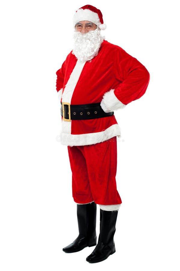 Το Santa είναι όλο το σύνολο για τους εορτασμούς Χριστουγέννων στοκ εικόνες