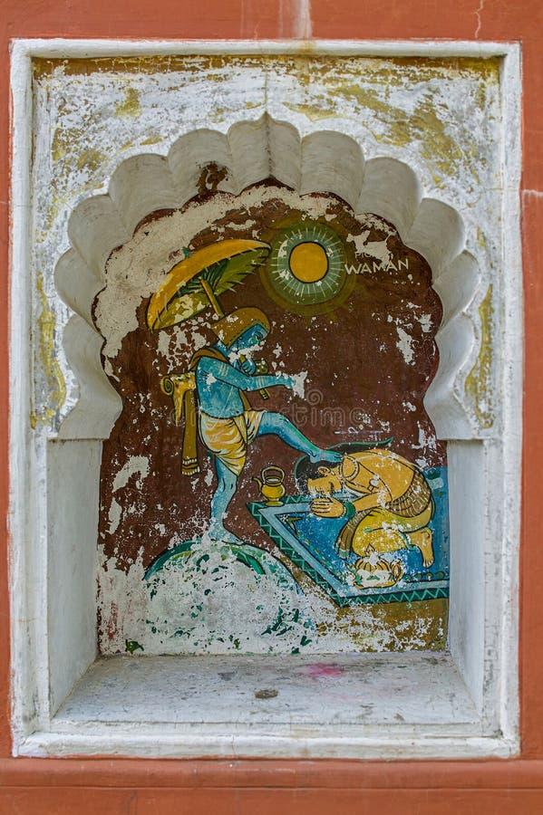 Το Vamanavtar ή η νάνα πέμπτη ενσάρκωση του Λόρδου Vishnu χρωμάτισε colourfully στον τοίχο του ναού Vishnu Narayan στην κορυφή Pa στοκ εικόνες