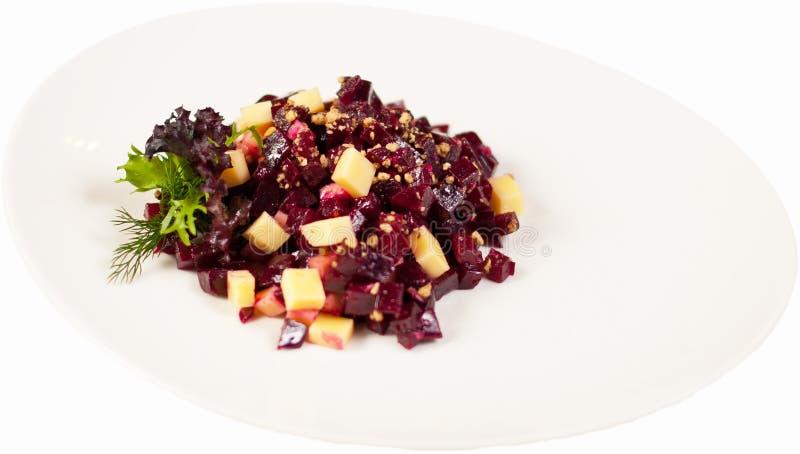 Το vinaigrette σαλάτας σε ένα πιάτο σε ένα άσπρο υπόβαθρο απομόνωσε κοντά επάνω στοκ φωτογραφία με δικαίωμα ελεύθερης χρήσης