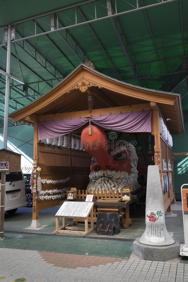 Το Yayoi Tengu, που βρίσκεται κάτω από το dori Yayoi, το κόκκινο αρσενικό πρόσωπο με μια μακριά, phallic μύτη, it's παρουσία εί στοκ εικόνες
