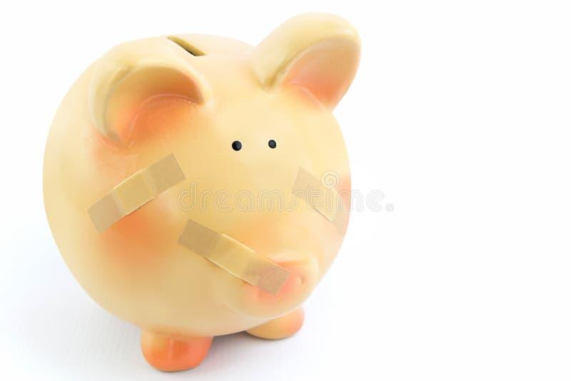 Τράπεζα Piggy τα ιατρικά μπαλώματα, που απομονώνονται με στοκ εικόνα