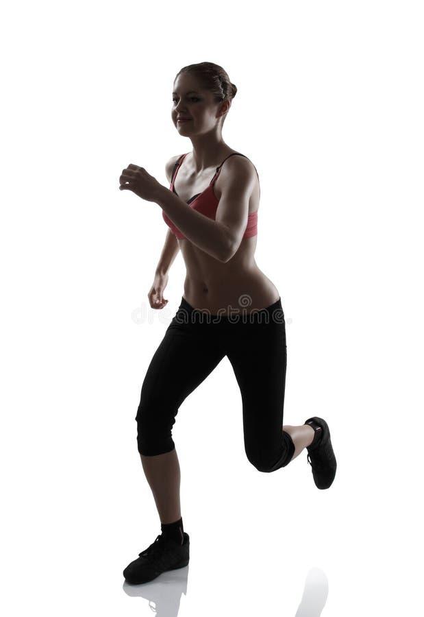Τρέχοντας αθλήτρια, στούντιο σκιαγραφιών που πυροβολείται πέρα από το λευκό στοκ εικόνες με δικαίωμα ελεύθερης χρήσης