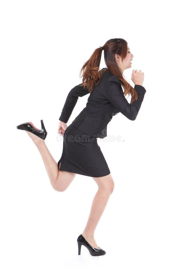 τρέχοντας γυναίκα επιχειρησιακού πλήρης μήκους στοκ φωτογραφία