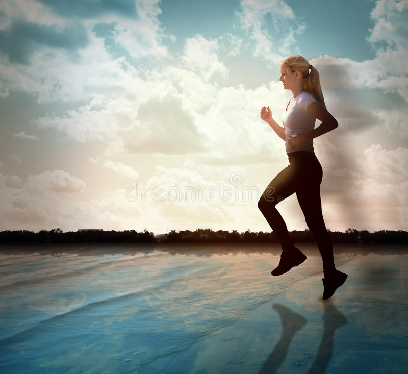 τρέχοντας γυναίκα ικανότη&t στοκ εικόνες