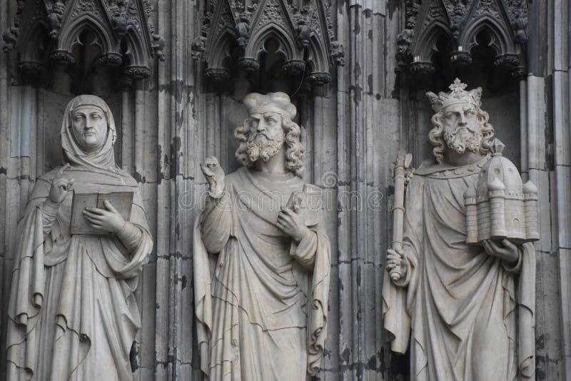 Τρία εξωτερικά αγάλματα, καθεδρικός ναός της Κολωνίας, Γερμανία στοκ εικόνα με δικαίωμα ελεύθερης χρήσης