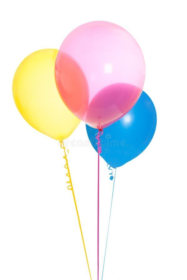 Τρία ζωηρόχρωμα μπαλόνια που απομονώνονται στοκ εικόνα