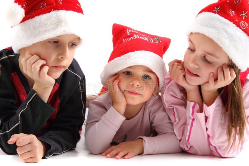Τρία κατσίκια στα καλύμματα Χριστουγέννων στοκ φωτογραφία