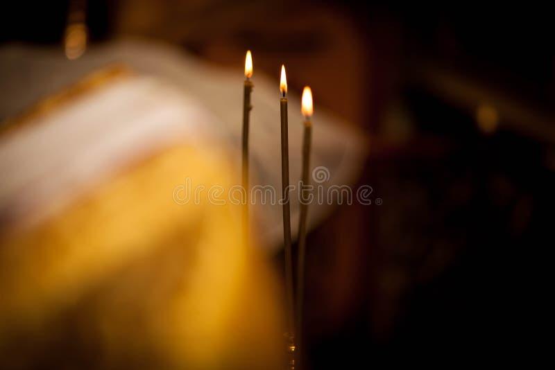 Τρία κεριά εκκλησιών στοκ εικόνα