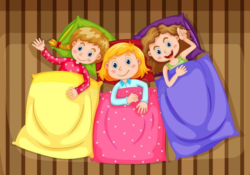 Τρία κορίτσια που παίρνουν έτοιμα για το κρεβάτι απεικόνιση αποθεμάτων