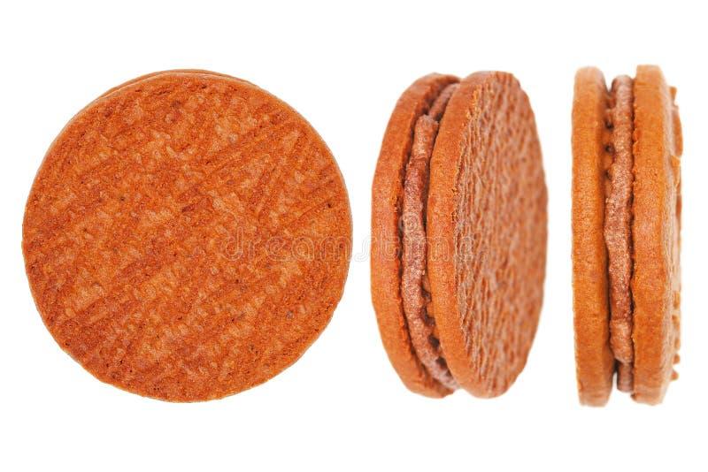 τρία μπισκότα που απομονώνονται στο λευκό στοκ εικόνες