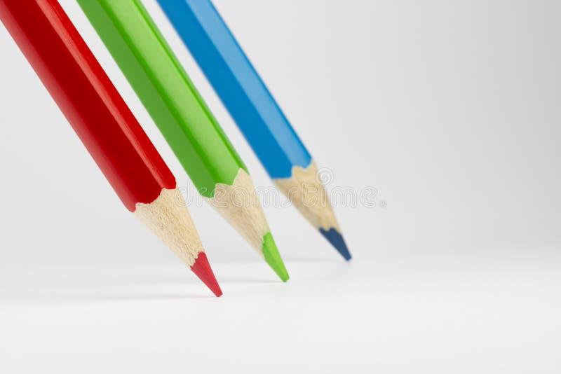 Τρία χρωματισμένα μολύβια στα RGB χρώματα στοκ εικόνες