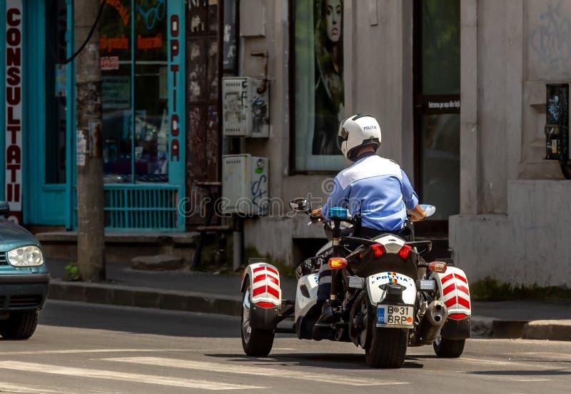 Τρίτροχη μοτοσικλέτα αστυνομικών στοκ εικόνες