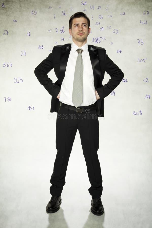 Τραπεζίτης και αριθμός στο κεφάλι του στοκ εικόνα