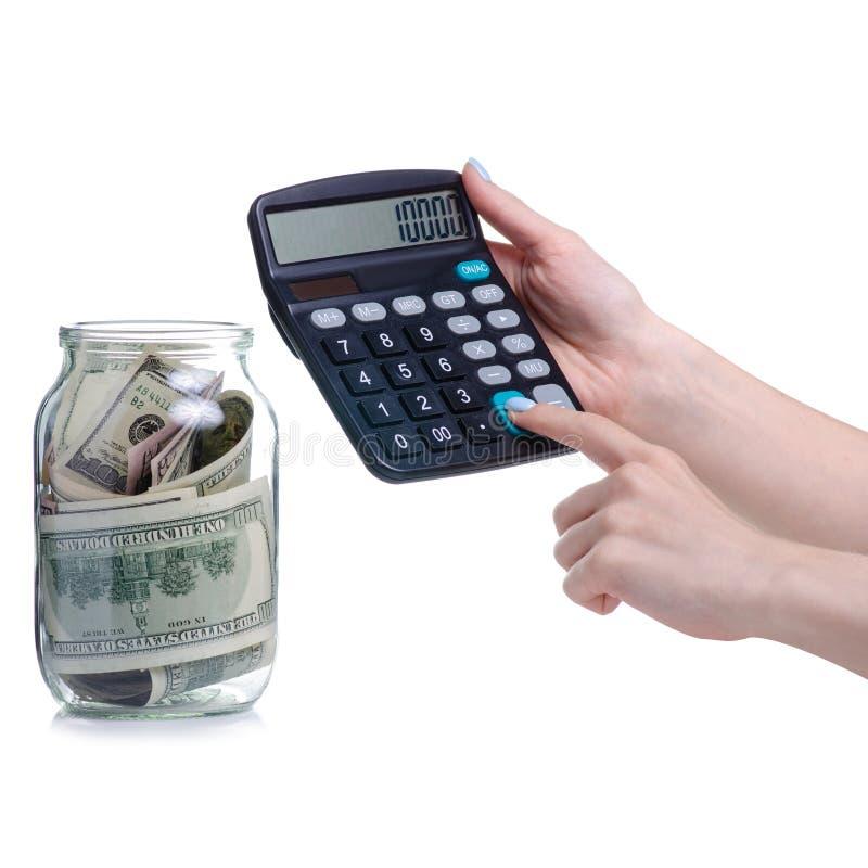 Τραπεζογραμμάτια δολαρίων χρημάτων στο βάζο και τον υπολογιστή γυαλιού στοκ εικόνες