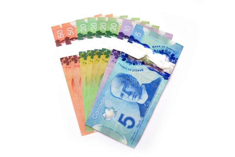 Τραπεζογραμμάτια καναδικών δολαρίων που απομονώνονται στο λευκό στοκ εικόνες με δικαίωμα ελεύθερης χρήσης